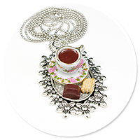 necklace tray with coffee and sweets