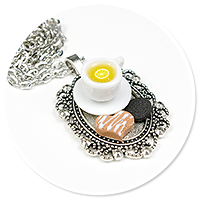 necklace tray with tea and sweets