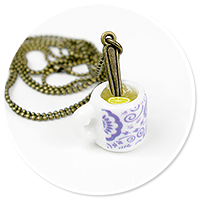 necklace with white mug of tea