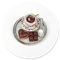 brooch of  tray with coffee and sweets
