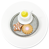 brooch of tray with tea and sweets